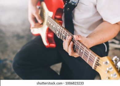 hand musician playing electric guitar.concept for live music background,Music festival.Instrument on stage
