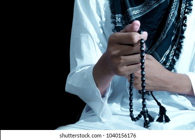 Hand of muslim people with praying gesture over dark background