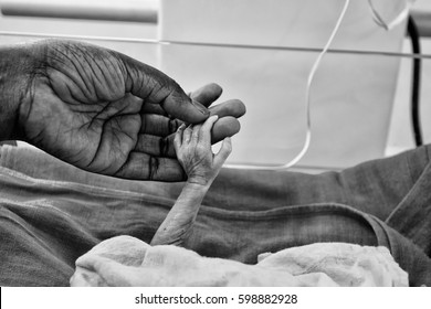 Hand of a newborn baby in a local hospital in Raxaul, India