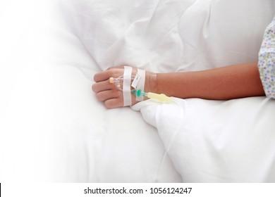 hand of nurse put intravenous(IV) injectionpatient on patient hand