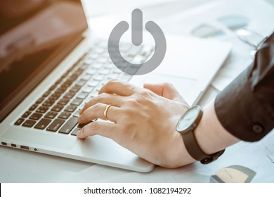 Hand of office man touching keypad for shut down computer notebook. He is married.