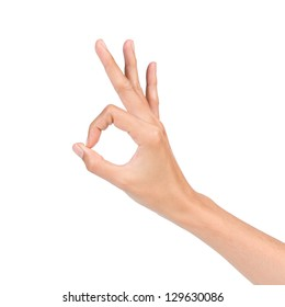 Hand OK sign isolated on white background
