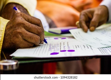 hand of an old man writing important legal document