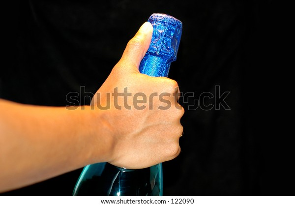 hand on the Bottle of wine