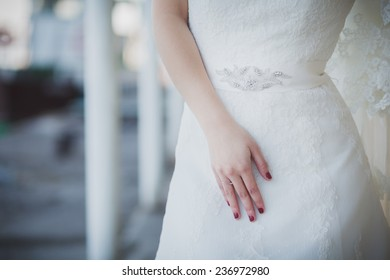 hand on the bride dress
