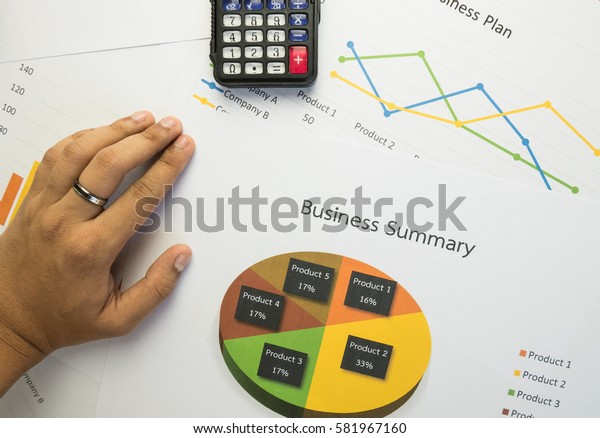 Hand on Business summary or Business plan report with Charts and graphs in Business concept, vintage style