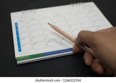 Hand on calendar 2019 in planning concept.
