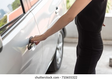 Hand on the car handle. Young woman holding to open the door.