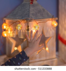 Hand on christmas lantern