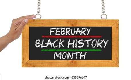 Hand on February Black History Month sign isolated on white background