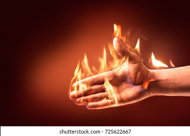 Hand on fire reaching out to shake