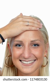hand on forehead of smiling blonde girl