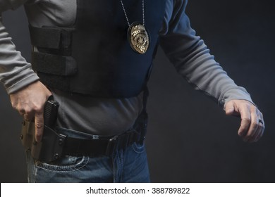 Hand on gun in holster.  Undercover Law Enforcement Special Agent with weapon.