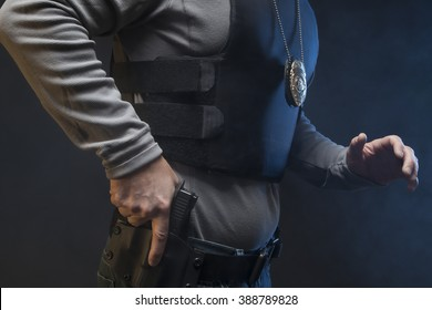Hand on gun and on the move.  Undercover Law Enforcement Special Agent with weapon.