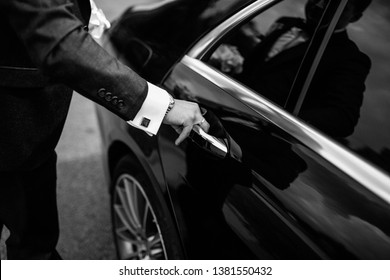 Hand on handle. Close-up of Asian man hand opening / close a car door, chauffeur car service background concept