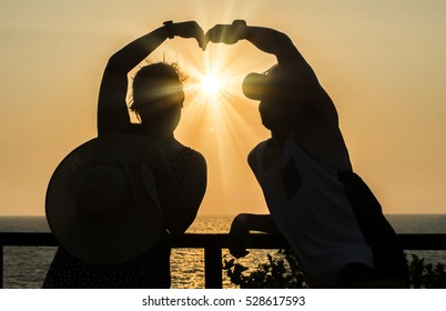 Hand on heart-shaped shadow and sun background Gradient