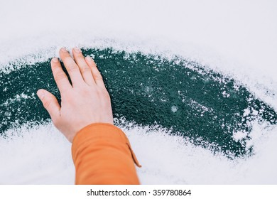 a hand on ice with snow