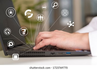 Hand on the keyboard and icons with technology. The concept of future development in technology.