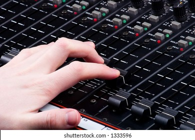 Hand on Mixing Console