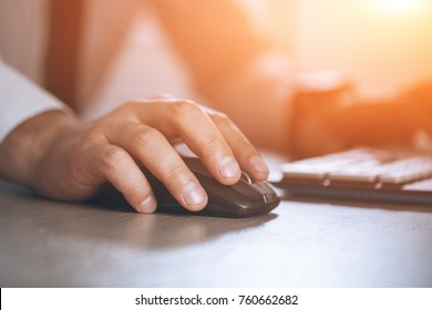 Hand on mouse. Businessman computer. Business success, contract and important document, paperwork or lawyer concept. Man in office. Warm glare of sun light for text and design.