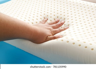 hand on orthopedic pillow, closeup
