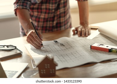 Hand on pencil of architect creative thinking in architectural design of modern house