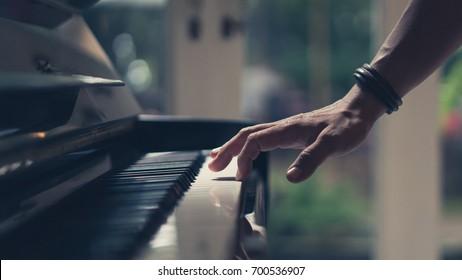 Hand On Piano Key