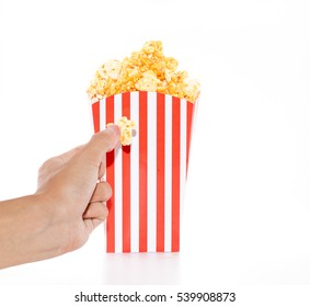 hand on Popcorn in red and white cardboard box