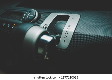 Hand on shifting automatic car gear to Low Drive 1