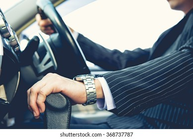 Hand on shifting the gear on car ,man driving car ,businessman ,vintage tone