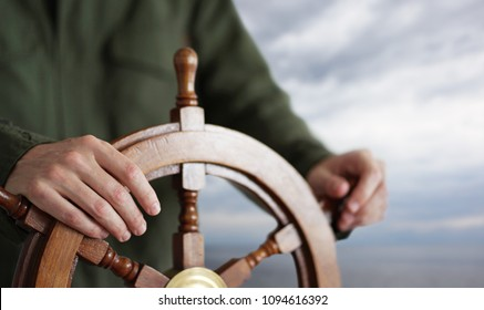 Hand on ship rudder.