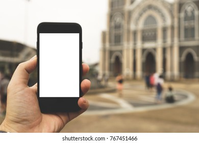 Hand on smartphone Blank Screen on Blur background