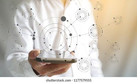 hand on smartphone with flowchart, business process concept