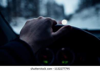 Hand on the steering Wheel in the car while driving