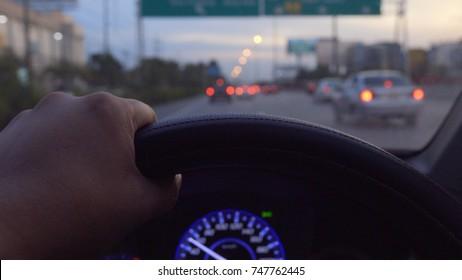 Hand on steering wheel close up