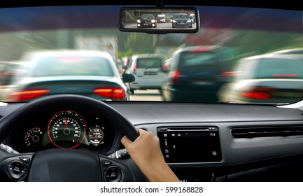 Hand on steering wheel during traffic jam