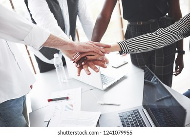 Hand on hand. Success conception. The young team came to an agreement after hard work.