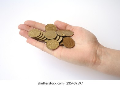 hand on a white background holding a handful of coins one hryvnia Ukraine. Inflation in Ukraine.