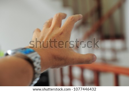 Hand One Man Trying Grab Empty Stock Photo (Edit Now
