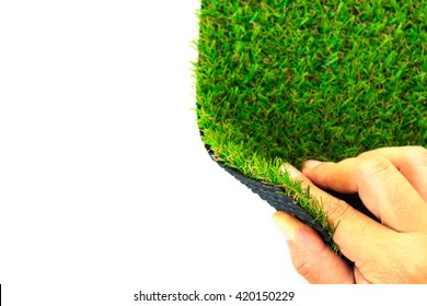 Hand open artificial grass with copy space for text on white background (selective focus)