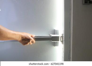Hand open fire door Dark black  Lighting To freedom