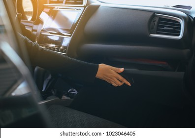 Hand open glove compartment box in car