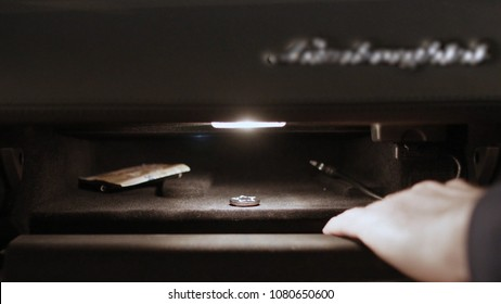 Hand open glove compartment box in car. Luxurious car glove compartment box with touch lock. glove compartment of cars