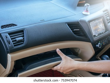 Hand open glove compartment box in car