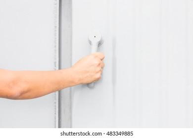 Hand open grey steel door industry or big boat
