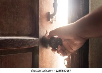 Hand open old door light