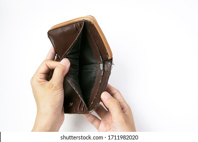 Hand open an old empty wallet or purse on white background, No Money