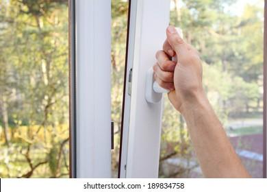 hand open plastic window