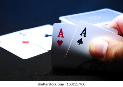 Hand open to see poker Cards in Casino,Pair of aces