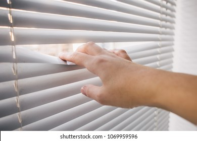 hand open window blinds, bright business ideas and concepts